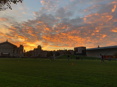 Admiring the sunset in Museumplein while Luis plays soccer!