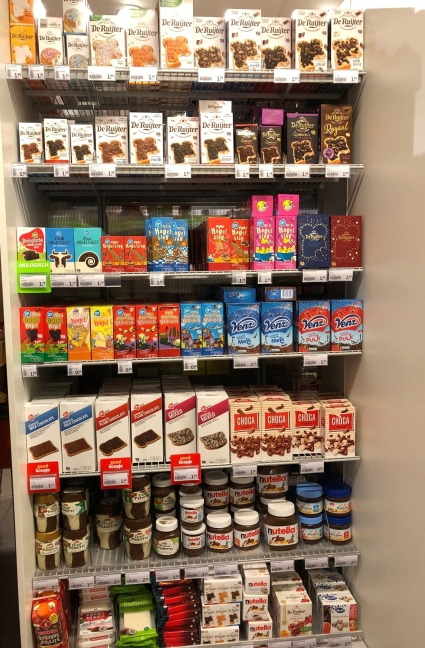 Supermarket stand with great variety of chocolate sprinkles and spreads