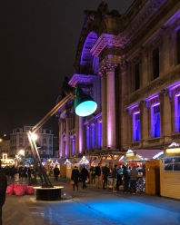 """Huge """"desk lamps"""" as public lighting. Stands of the Christmas market."""