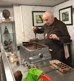 Measuring the chocolate temperature.