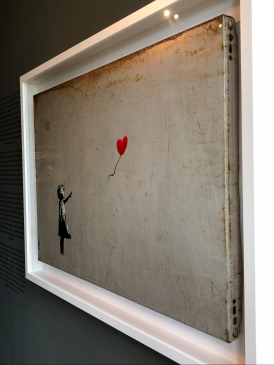 """There is always hope"". This is one of Banksy's most popular artwork, in this occasion painted in a metal piece. However, it has been painted on many different surfaces and multiple occasions."