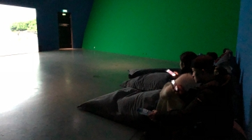Beanbags to watch the miniclips of the temporary exhibition