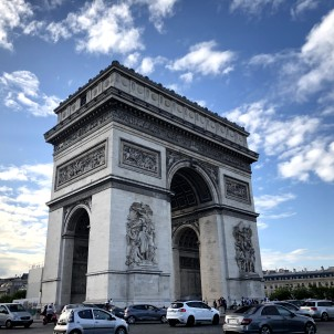Arc de Triomphe, built to honour those who fought and died in the French Revolution and the victories of Napoleon Bonaparte. Stunning building with impressive engraved details.