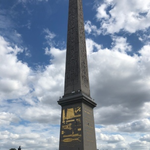 A giant obelisk decorated with Egyptian hieroglyphics.